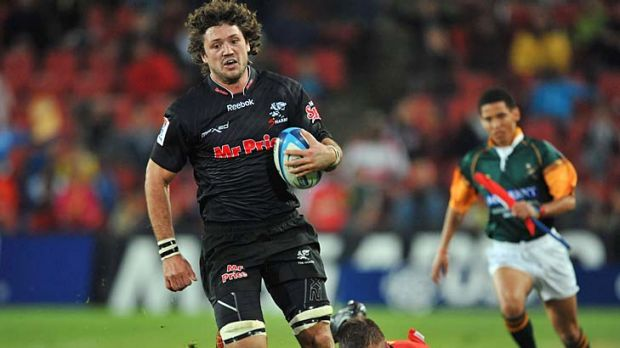 Ryan Kankowski of the Sharks makes a break in the lead-up to the try scored by JP Pietersen.
