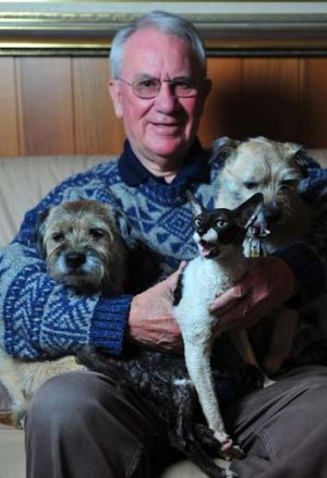 Hugh Wirth at home with his dogs, Lachlan and Miss Lexie and cat Molly.