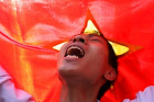 TOPSHOTS A protester shouts anti-China slogans in front of the Chinese embassy in Hanoi during a protest against the ...