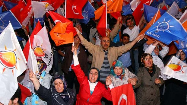 Victorious AKP supporters congratulate Turkish Prime Minister Recep Tayyip Erdogan.