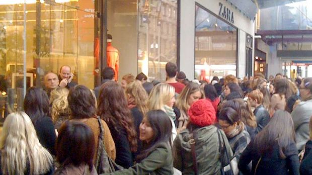 Shoppers queue to be among the first to part with their money at Zara's Bourke St store.
