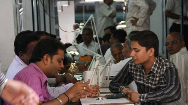 Diamond traders do business on the streets of Surat.