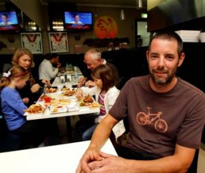 Dave Pegrum and his family enjoy the chook at Charcoal Kingdom.