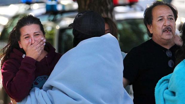 Jessica Reyes, Jason Valdez's sister, and his father, Duane Valdez, react after hearing a loud explosion as SWAT teams ...