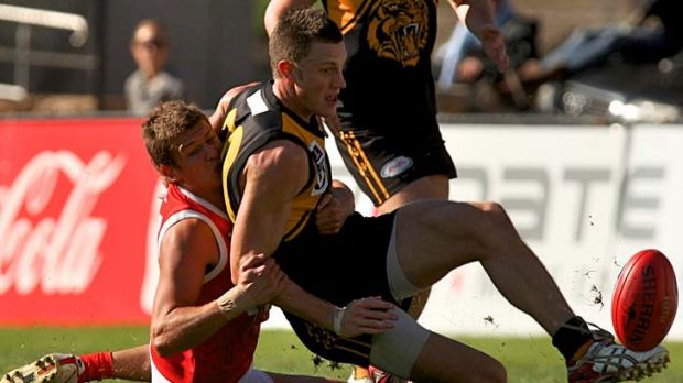 Travis Tuck (kicking the footy) has resumed his football career with VFL team Werribee.