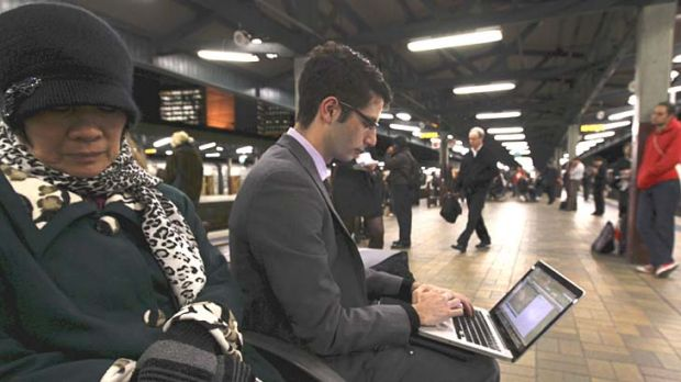 Don't waste a minute ... Jakeb Brown gets in a few more keystrokes as he waits for his train home to Newcastle, a trip ...