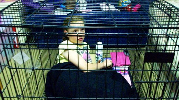 Nerang school girl Sarah Braund locked herself in a cage for a day to bring attention to aminal cruelty.