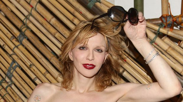 Injured ... Courtney Love suffers burns in house fire.