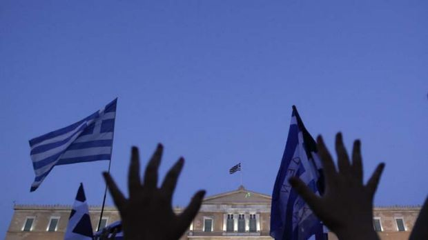 Greek citizens rally as the debt-saddled nation fights off bankruptcy.