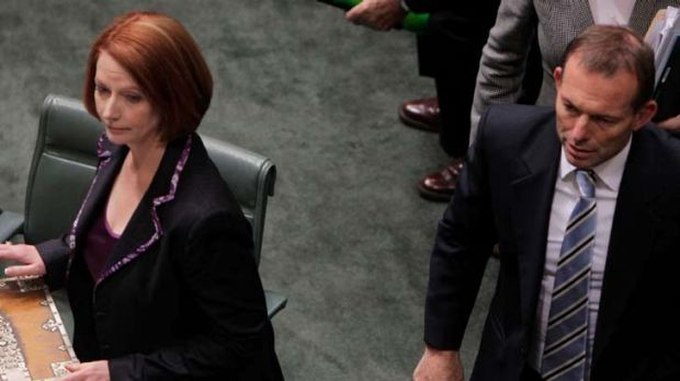 Battle field ... Prime Minister Julia Gillard and Opposition Leader Tony Abbott in the House.