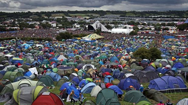 Rain clouds gather over the Pyramid Stage and tent city at Glastonbury Festival site at Worthy Farm, England.