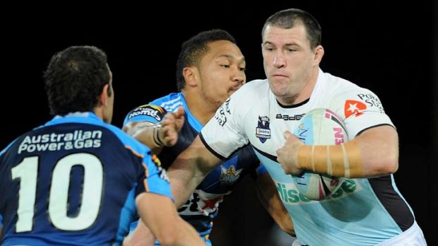 Paul Gallen runs the ball against the Gold Coast Titans.