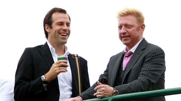 Former pros Greg Rusedski and Boris Becker at the Wimbledon championships on Saturday.