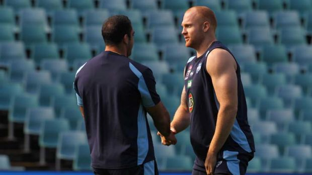 Galloway with Tim Mannah at Blues training yesterday.