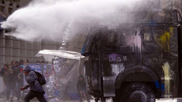 Protesters are targeted by police water cannon during  demonstrations.