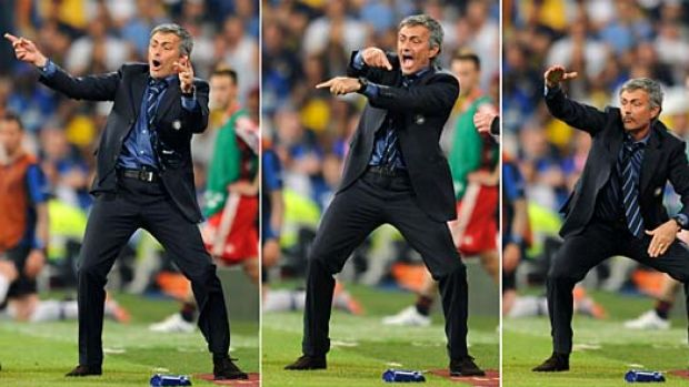 Inter Milan's Portuguese coach Jose Mourinho gestures to his players during the UEFA Champions League final football ...
