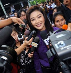 Yingluck Shinawatra faces the media after voting in the Thailand election.