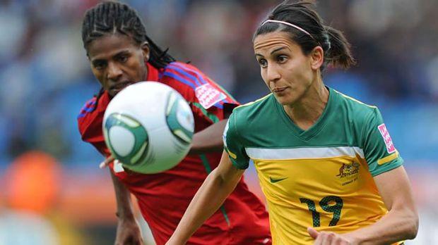 Equatorial Guinea defender Bruna, left, vies for the ball with Australia striker Leena Khamis