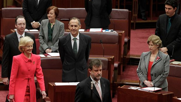 Governor-General Quentin Bryce is escorted into the Senate Chamber, passing Greens Leader Bob Brown and Greens Deputy ...