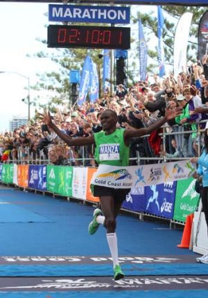 Nicholas Manza crosses the finish line in the Gold Coast marathon .... so close yet so far from bonus cash prize.