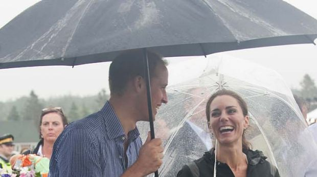 Prince William, Duke of Cambridge and Catherine, Duchess of Cambridge have a walkabout in the rain.