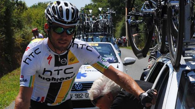 Mark Cavendish has his bike checked by a mechanic during an unhappy stage 3 for the British rider.