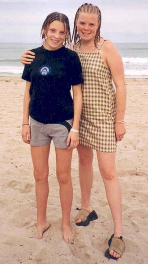 Milly Dowler, left,  poses with her sister Gemma on holiday in Cuba in an undated photo.