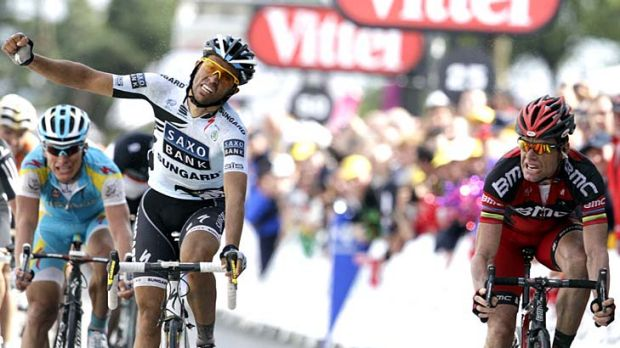 Premature celebration .... Alberto Contador of Spain raises his fist as he believes he has pipped Cadel Evans to the ...