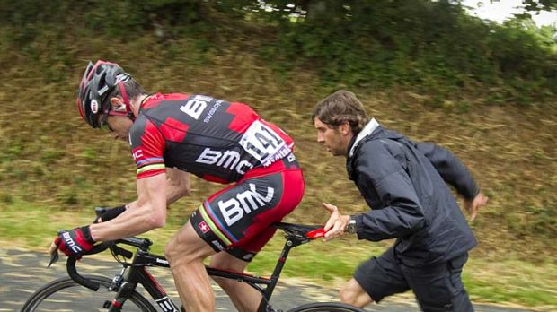 In trouble ... Cadel Evans of Australia is helped after a mechanical problem with his bike..