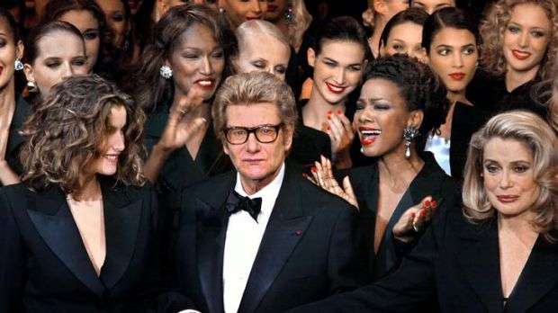 Suited to the job ... Yves Saint Laurent, centre, popularised Les Smoking as unisex garments.