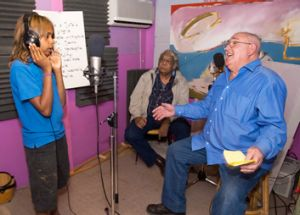 The late Ntaria leader Ntjalka Williams  watches country music star Ted Egan and a child singer from Hermannsburg at the ...