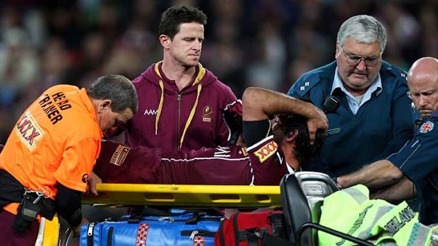 A distressed Johnathan Thurston leaves the field on a medicab.