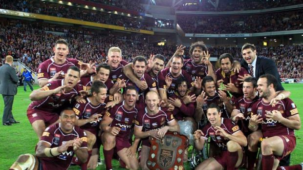 Perfect performance ... the Queensland team pose with the shield.