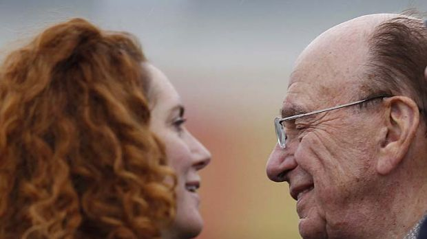 Still in her job ...  Rebekah Brooks, pictured with Rupert Murdoch.