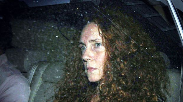 News International chief executive Rebekah Brooks leaves the office of The News of The World overnight.