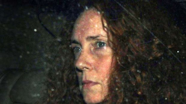 News International chief executive Rebekah Brooks leaves the office of The News of The World on Thursday.