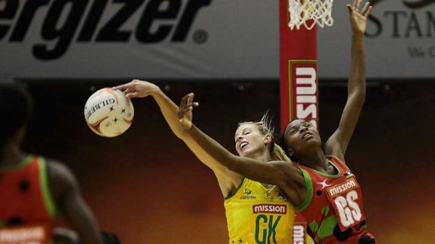 Laura Geitz of Australia and Mwayi Kumwenda of Malawi (R) compete for the ball.