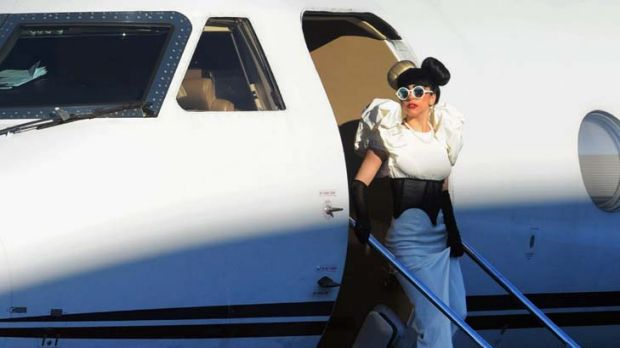 Arrival ... Lady Gaga emerges from her plane 30 minutes after touching down.