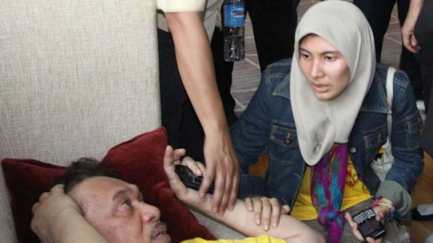 The Opposition leader, Anwar Ibrahim, lies injured at a rally.