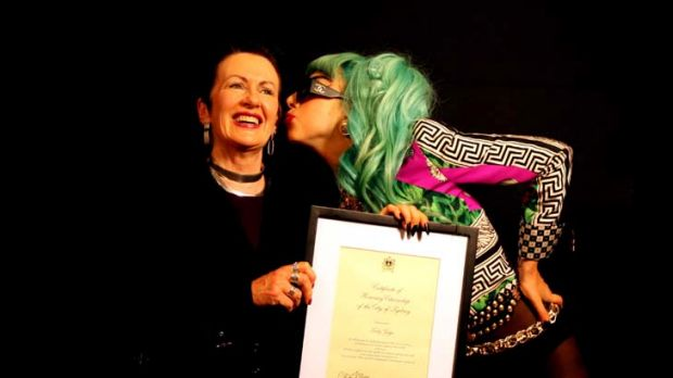 Lord Mayor Clover Moore presents Lady Gaga with a certificate of honorary citizenship to the city of Sydney.
