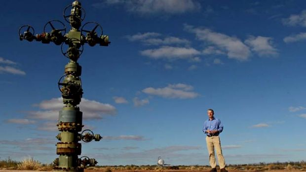 Petratherm exploration manager Peter Reid at a geothermal wellhead in South Australia. Petratherm is drilling to ...