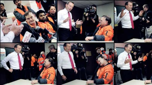 Opposition Leader Tony Abbott gets a rise out of forklift driver Darryl Betts as the pair argue the merits of a carbon ...