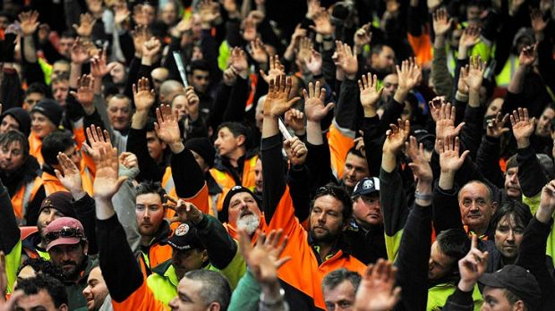 Popular vote: CFMEU members at Festival Hall approve a new work agreement that will give a labourer $123,000 for a ...