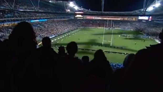 Shadows from bomber planes sweep across Suncorp Stadium in a scene from the Brisbane Bombers video.