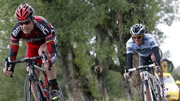Pressure applied ... Cadel Evans starts gaining time on his rivals on the final descent.