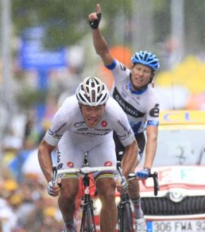 Ryder Hesjedal celebrates as teammate Thor Hushovd with's the 18th stage of the Tour de France.