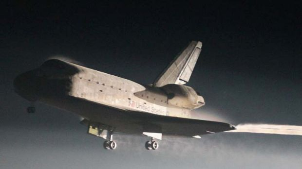 Touchdown ... Atlantis comes in to land at Kennedy Space Centre.
