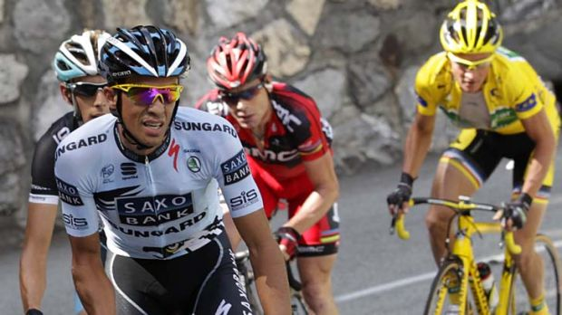 Aggressive rider ... Alberto Contador attacks on the ascent of the Col du Telegraph with Andy Schleck, Cadel Evans and ...