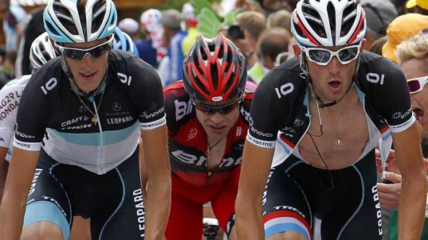 Schleck sandwich ... Cadel Evans rides behind Andy and Frank Schleck on  l'Alpe d'Huez.