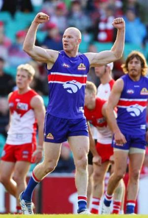 The Western Bulldogs' Barry Hall celebrates a goal against Sydney, one of his former sides, at the SCG.
